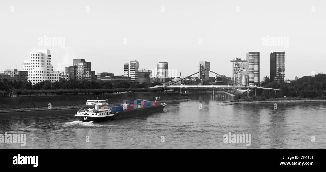 Dutch container ship making a turn into the harbour of Dusseldorf, Germany Stock Photo