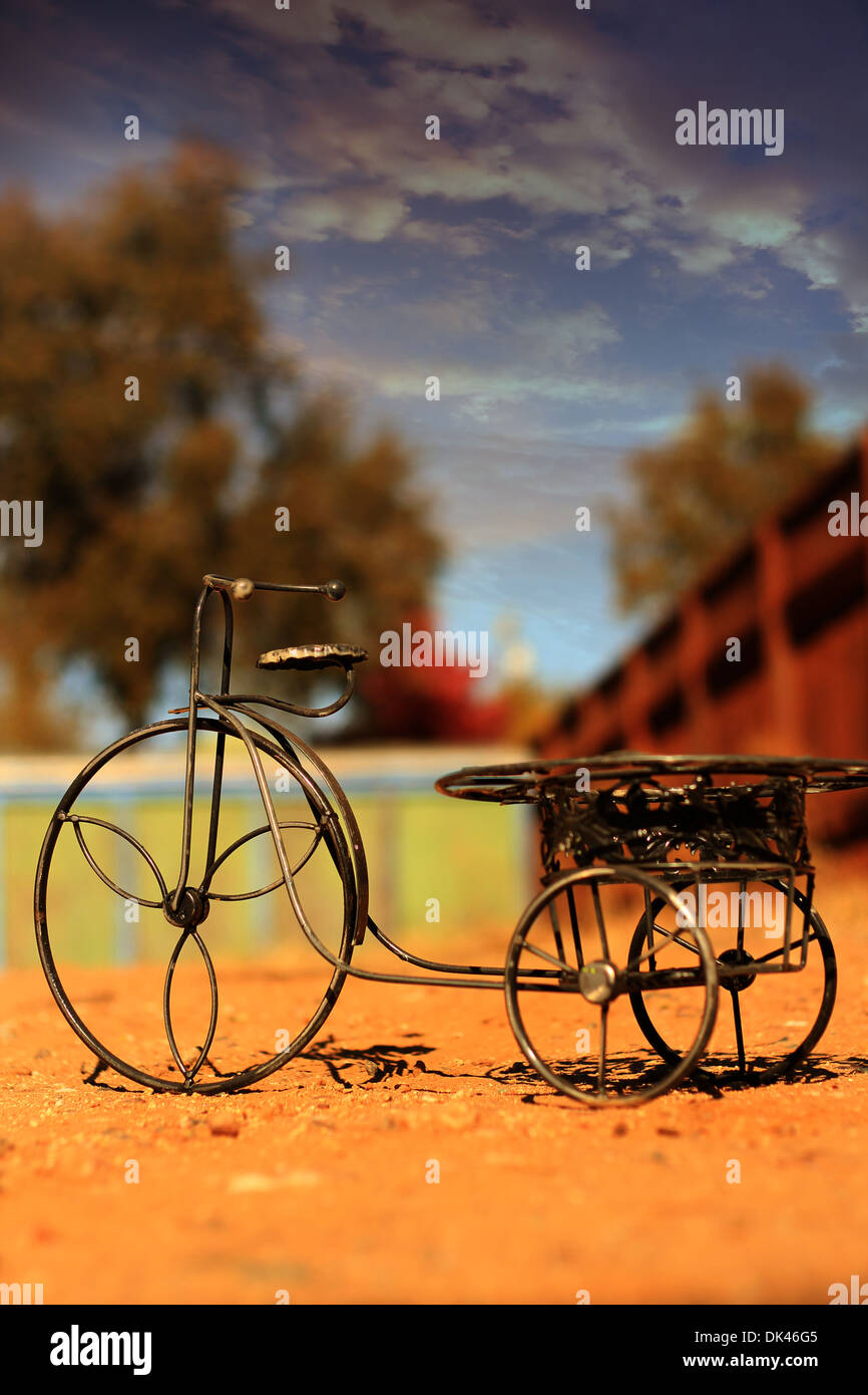 Wire Tricycle, warm colors - Stock Image