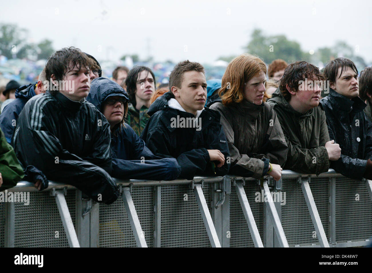 audience watching the duke spirit band performing at the glastonbury festival 2004