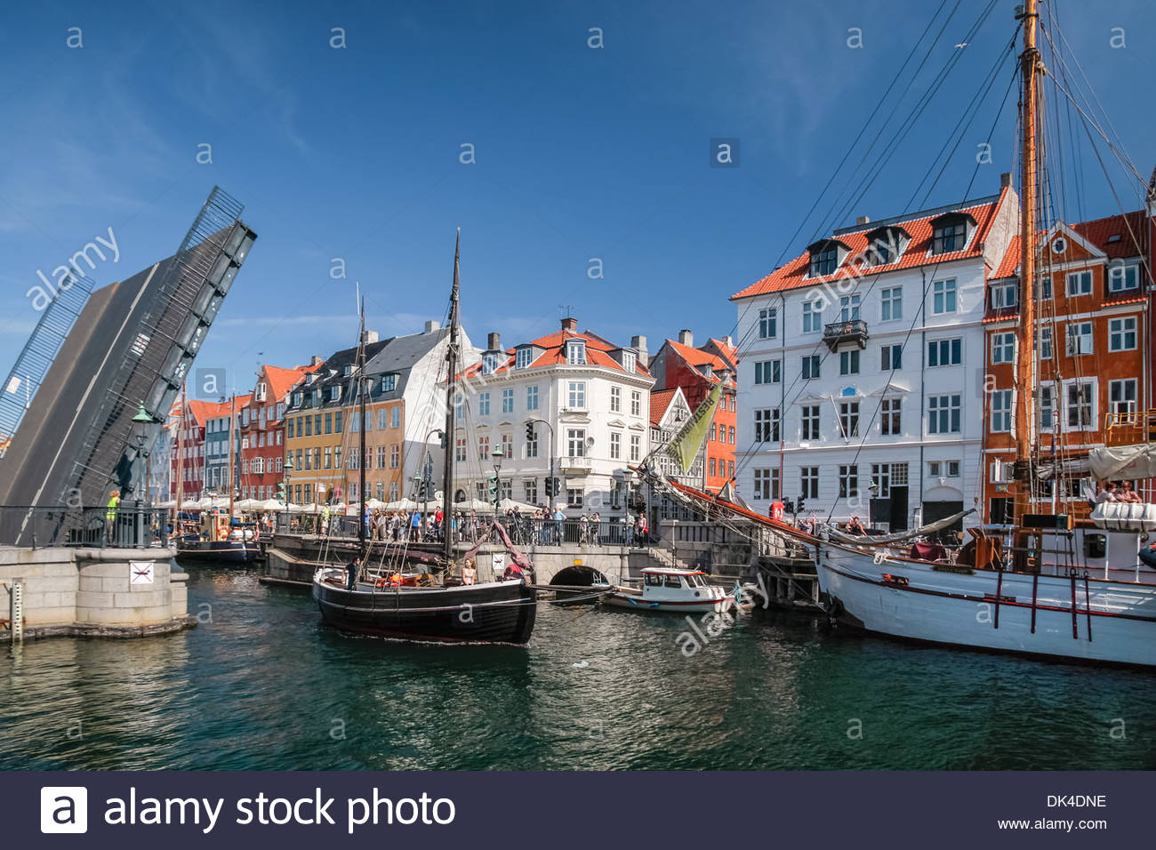 Drawbridge with sail boat in Nyhavn in Copenhagen, Denmark - Stock Image