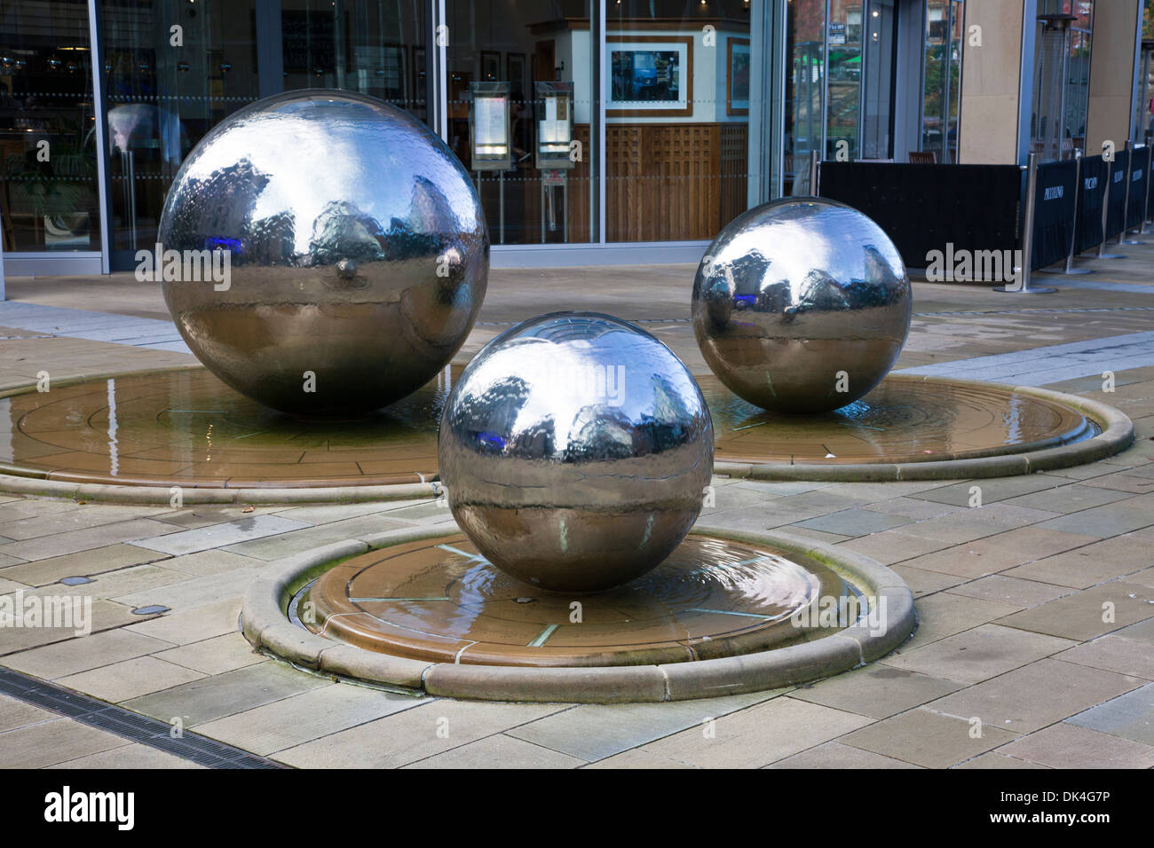 Three silver balls with flowing water, Sheffield (South Yorkshire, England) forming urban design features within the city center - Stock Image
