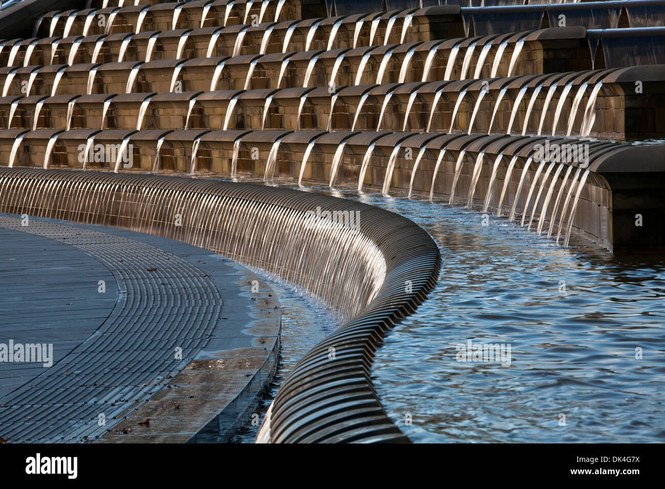 CASCADING, SINUOUS, WATER FEATURE AS PART OF URBAN DESIGN, TRAIN STATION SQUARE, SHEFFIELD, SOUTH YORKSHIRE, ENGLAND - Stock Image