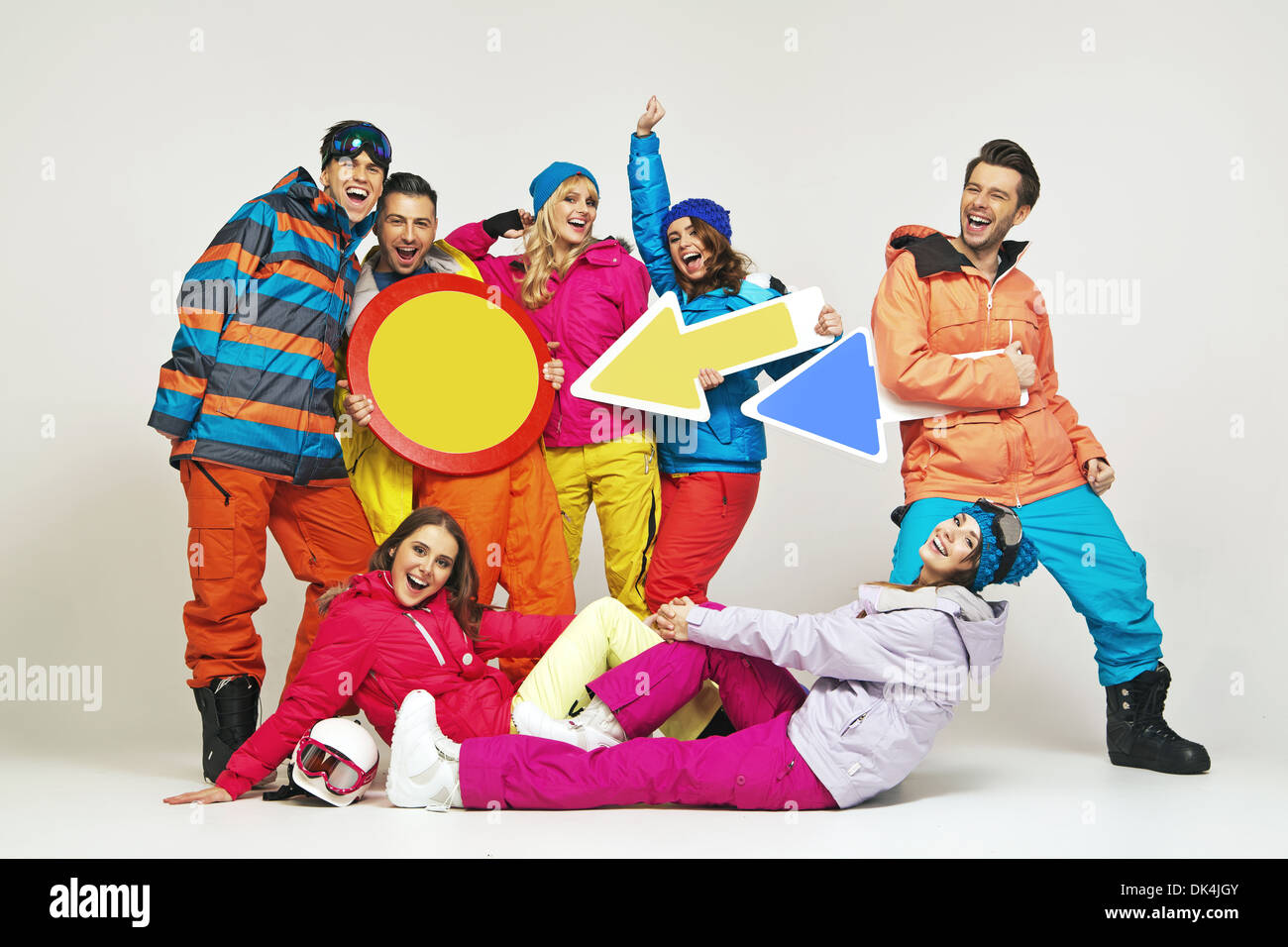 Colorful photo of the glad young snowboarders - Stock Image