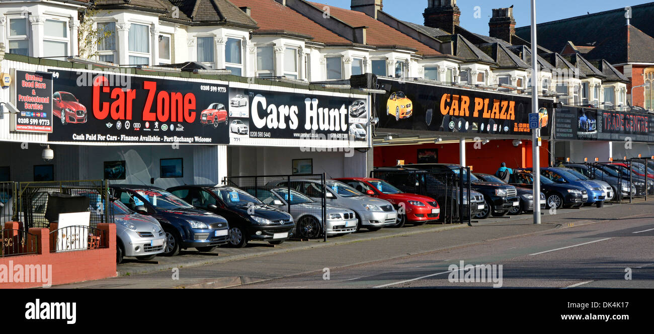 Secondhand car dealers forecourts created from ground floors & front gardens of residential properties (obscured numberplates) - Stock Image