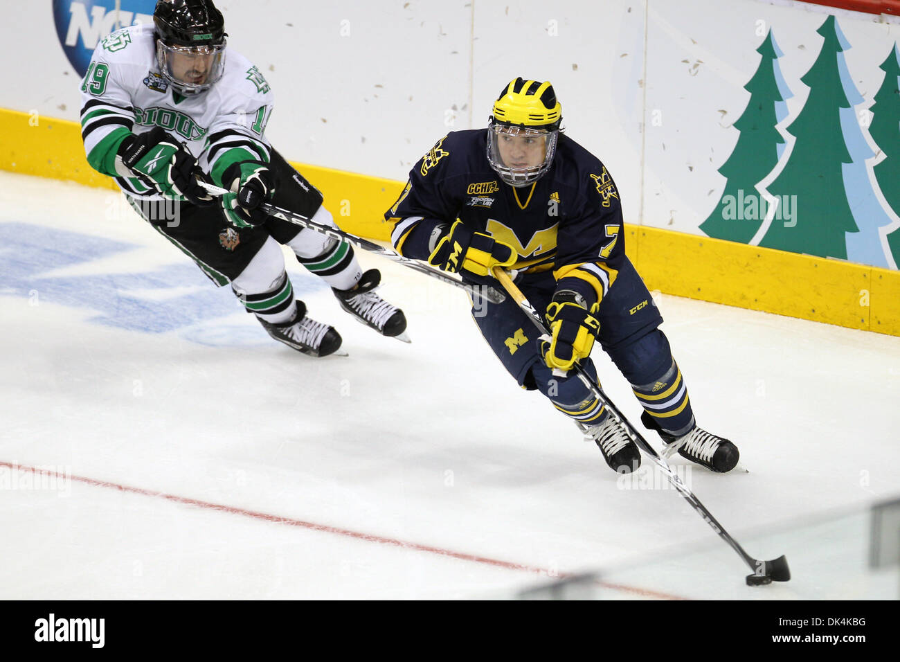 Apr. 7, 2011 - St Paul, Minnesota, U.S - Michigan defenseman Chad Langlais (7) is chased by North Dakota left wing Evan Trupp (19) in the first period of the NCAA Frozen Four between the University of Michigan Wolverines and the University of North Dakota Fighting Sioux at the Xcel Energy Center St, Paul, MN. After the first period Michigan led 1-0. (Credit Image: © Steve Kotvis/So - Stock Image