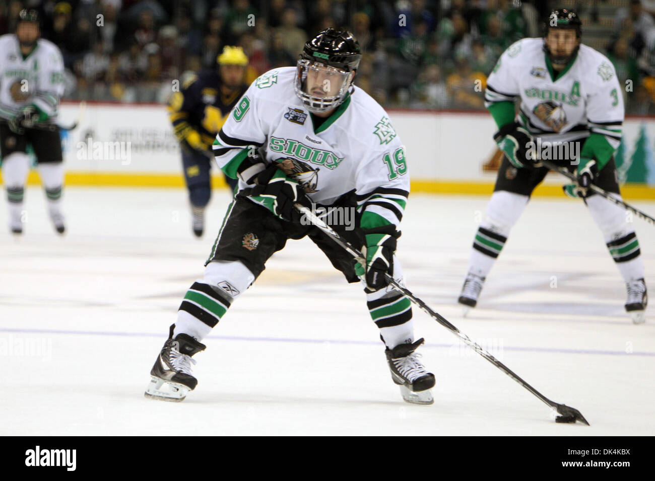 Apr. 7, 2011 - St Paul, Minnesota, U.S - University of North Dakota Fighting Sioux forward Evan Trupp (19) tees up the puck in the second period of the NCAA Frozen Four between the University of Michigan Wolverines and the North Dakota Fighting Sioux at the Xcel Energy Center St, Paul, MN. The score remained 1-0 Michigan after two periods. (Credit Image: © Steve Kotvis/Southcreek G - Stock Image