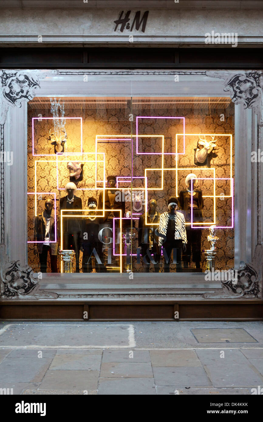 H&M clothing store winter window display - Stock Image