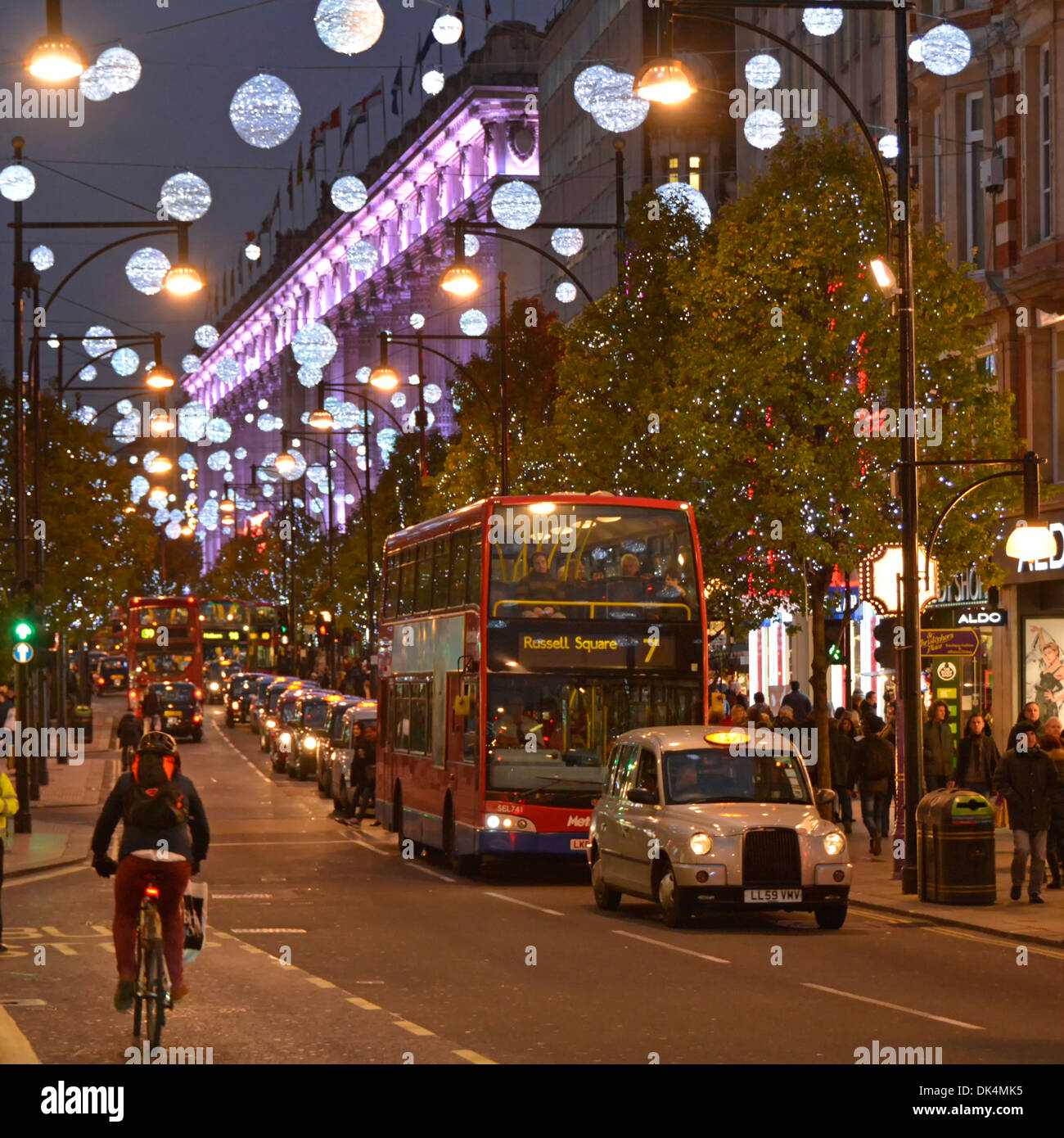 Oxford Street Christmas decorations with Selfridges illuminated store facade - Stock Image