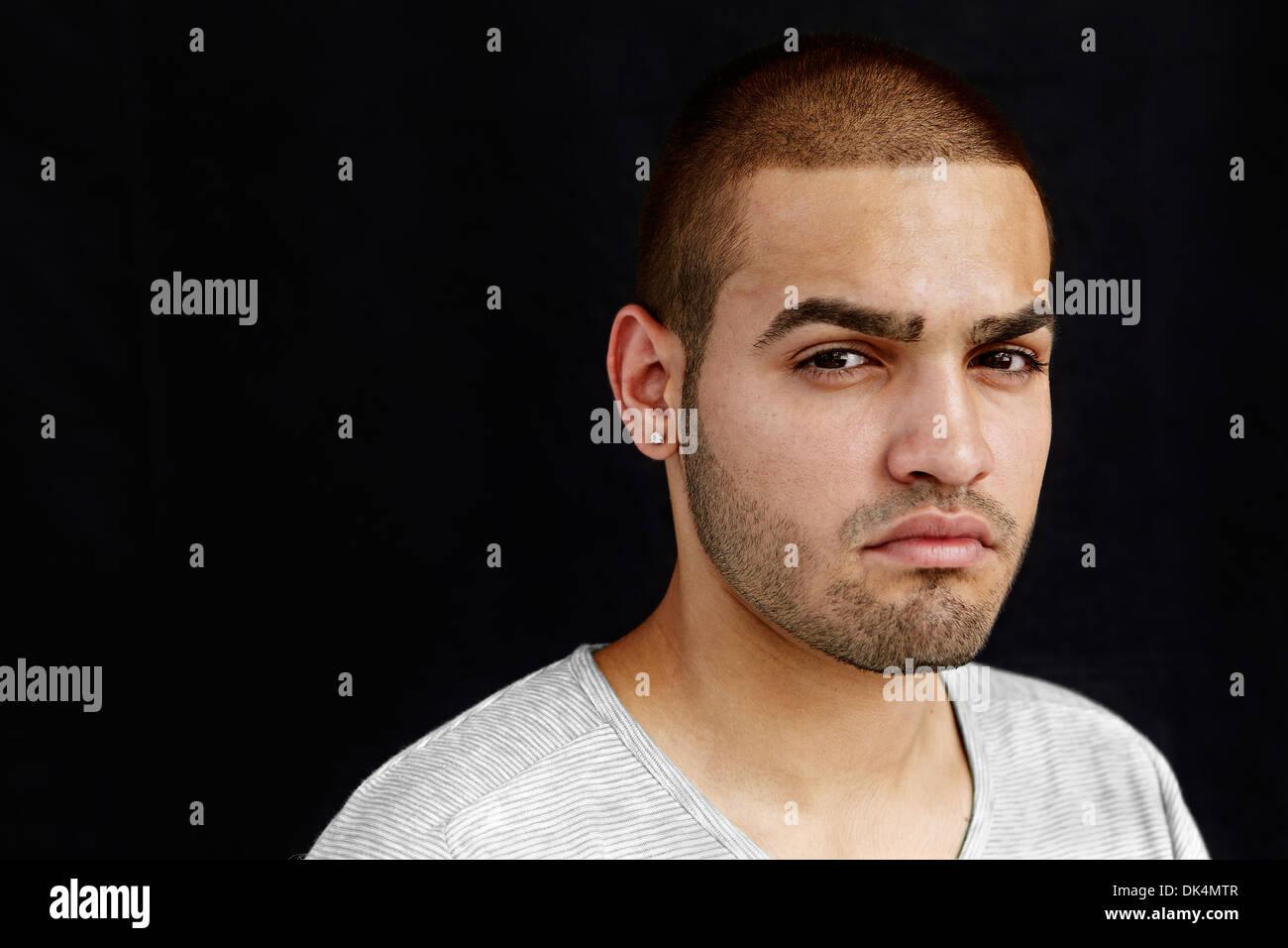 Portrait of Latino man looking at camera - Stock Image