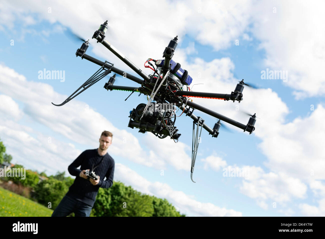 Technician Flying UAV Helicopter in Park - Stock Image