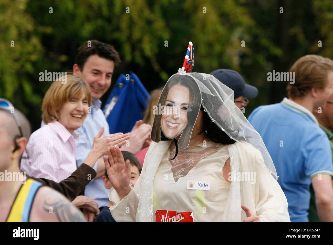 Apr 17, 2011 - London, England, United Kingdom - Runner dressed in wedding outfit with Kate Middleton mask during Stock Photo