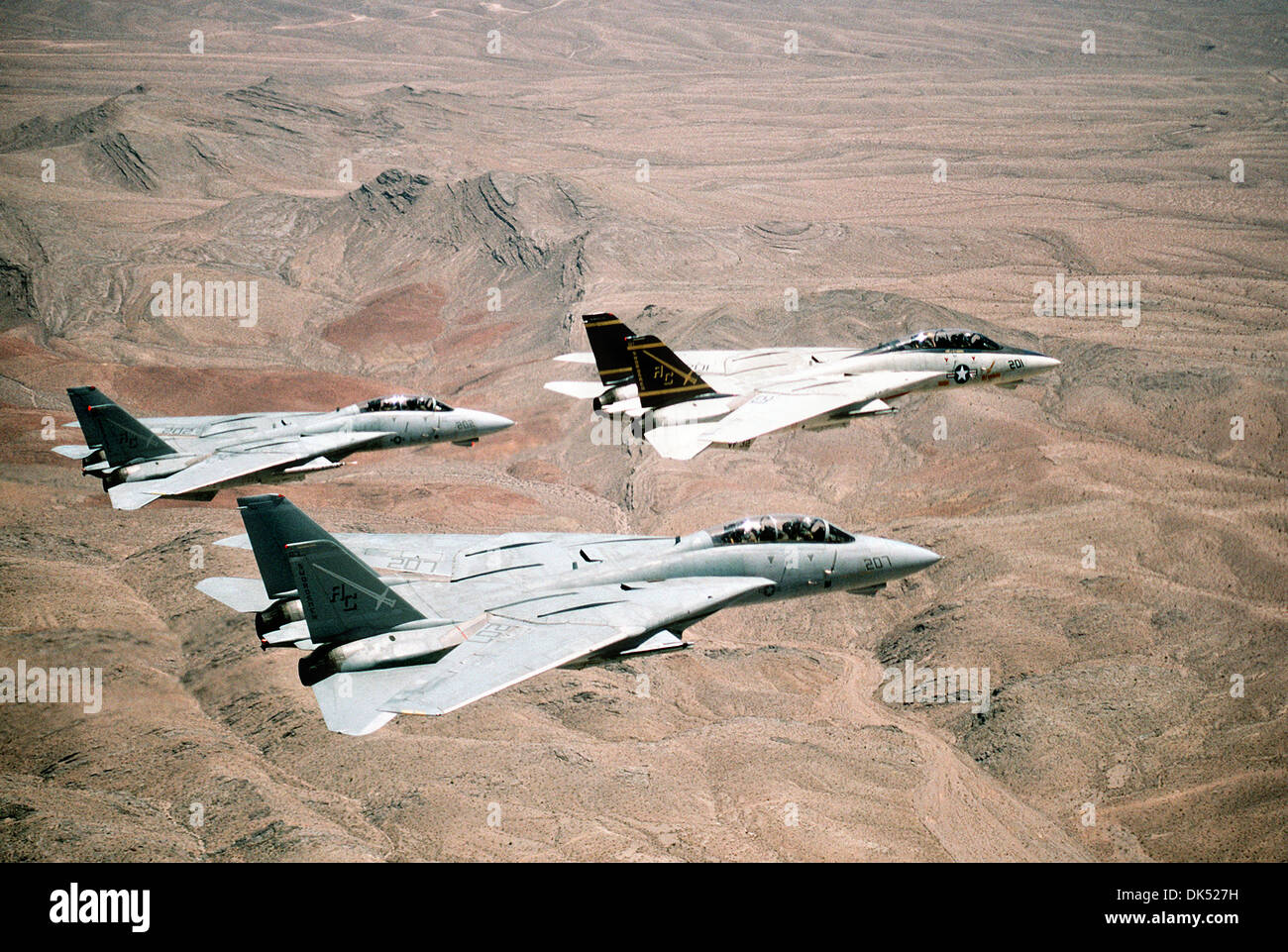 A US Navy Fighter Squadron of F-14A Tomcat fighter aircraft fly in formation over the desert during Operation Desert Storm February 7, 1991 in Kuwait. - Stock Image