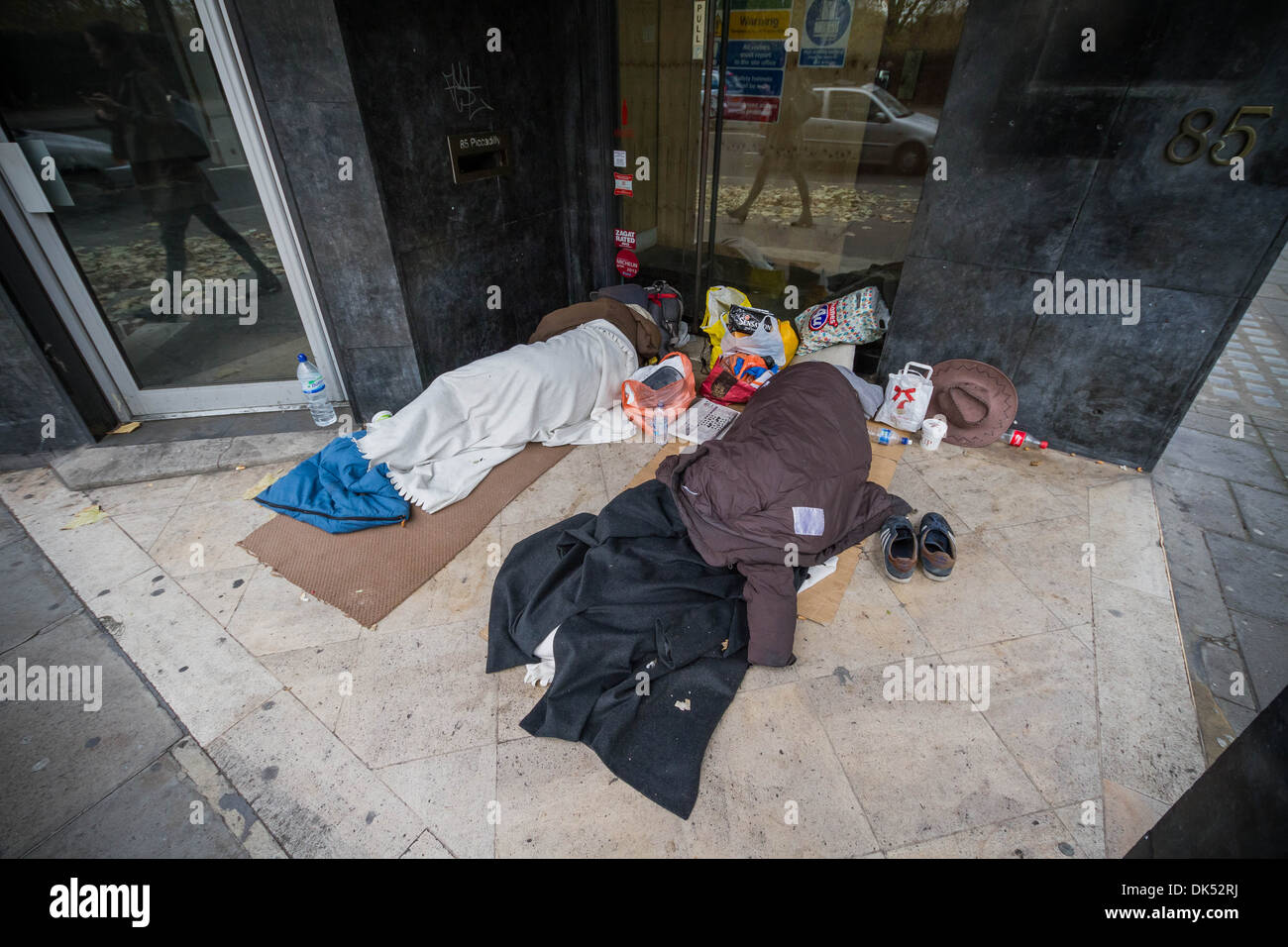 Rough sleepers in a doorway during the day. Green Park, London, UK. - Stock Image