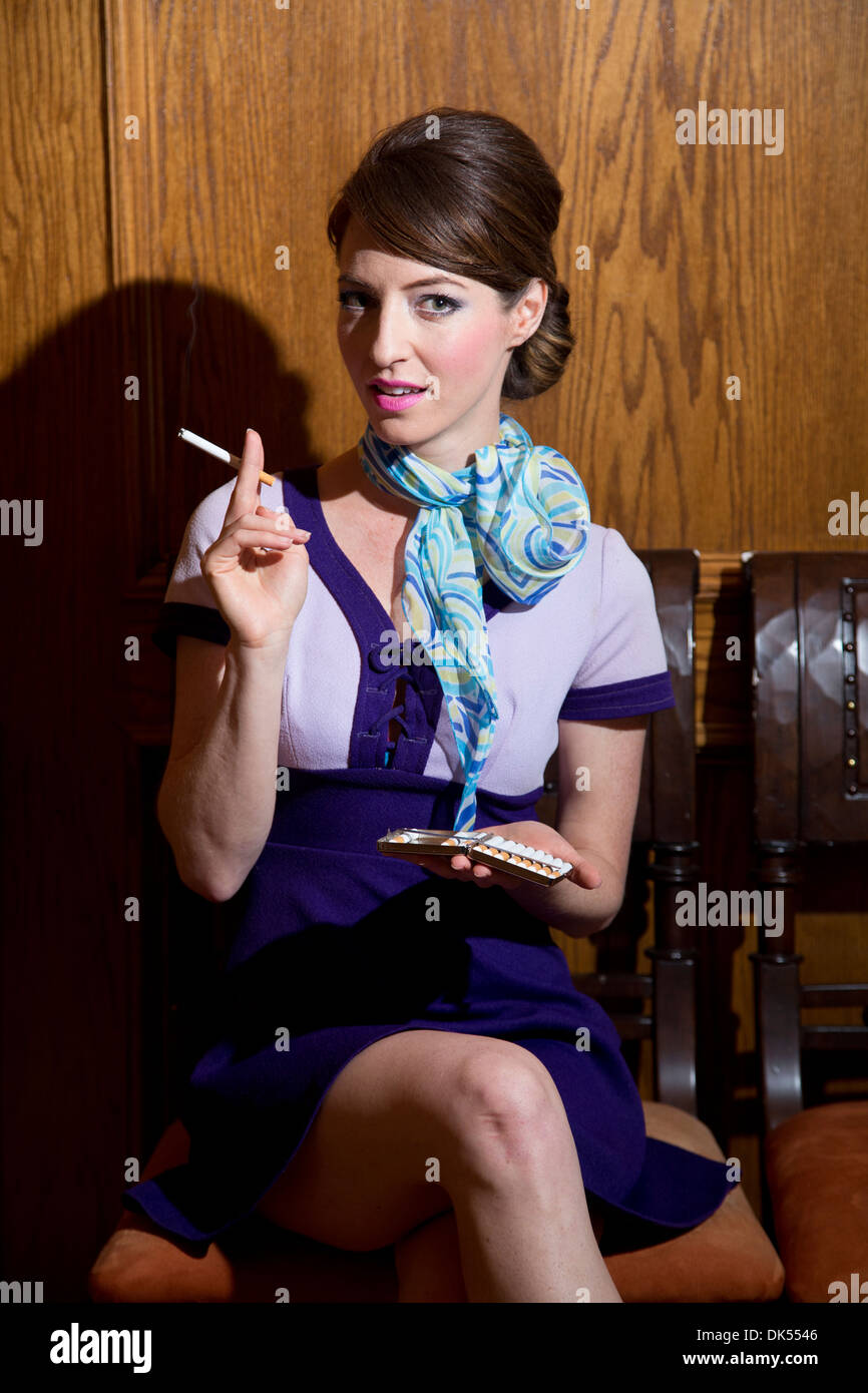 Attractive Young Woman with a Cigarette - Stock Image
