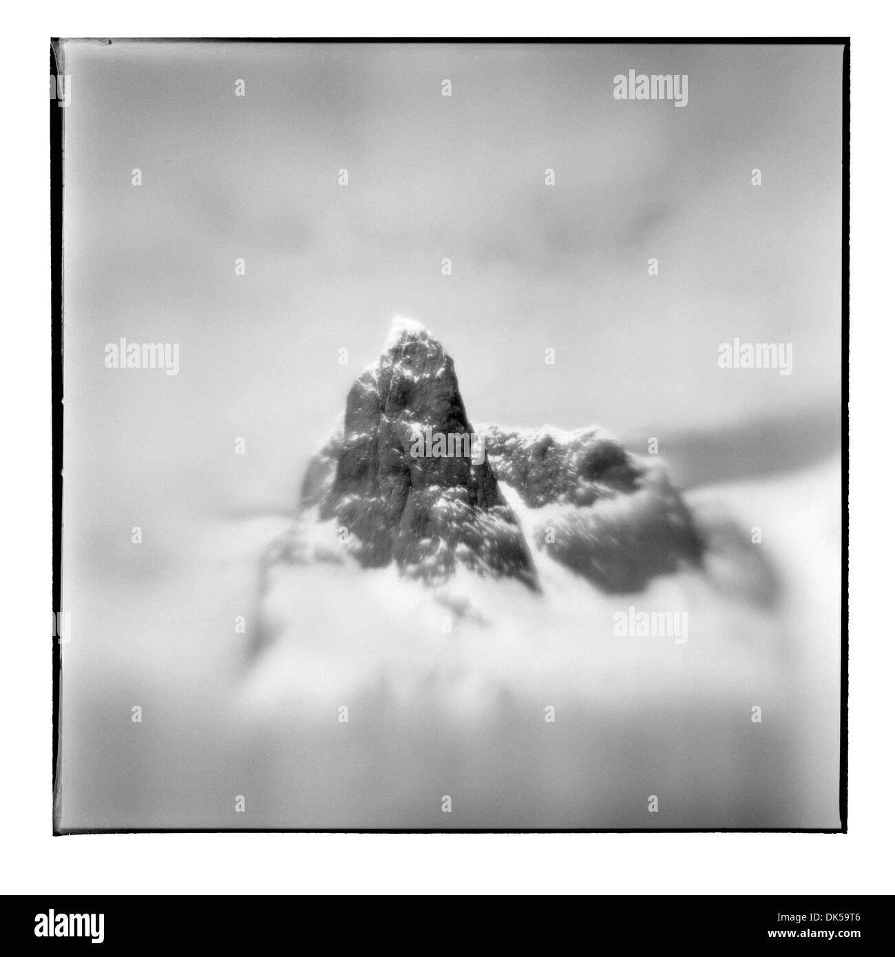 Antarctica, Blurred black and white image of mountain peaks near Cape Renard along Lemaire Channel on sunny summer afternoon - Stock Image