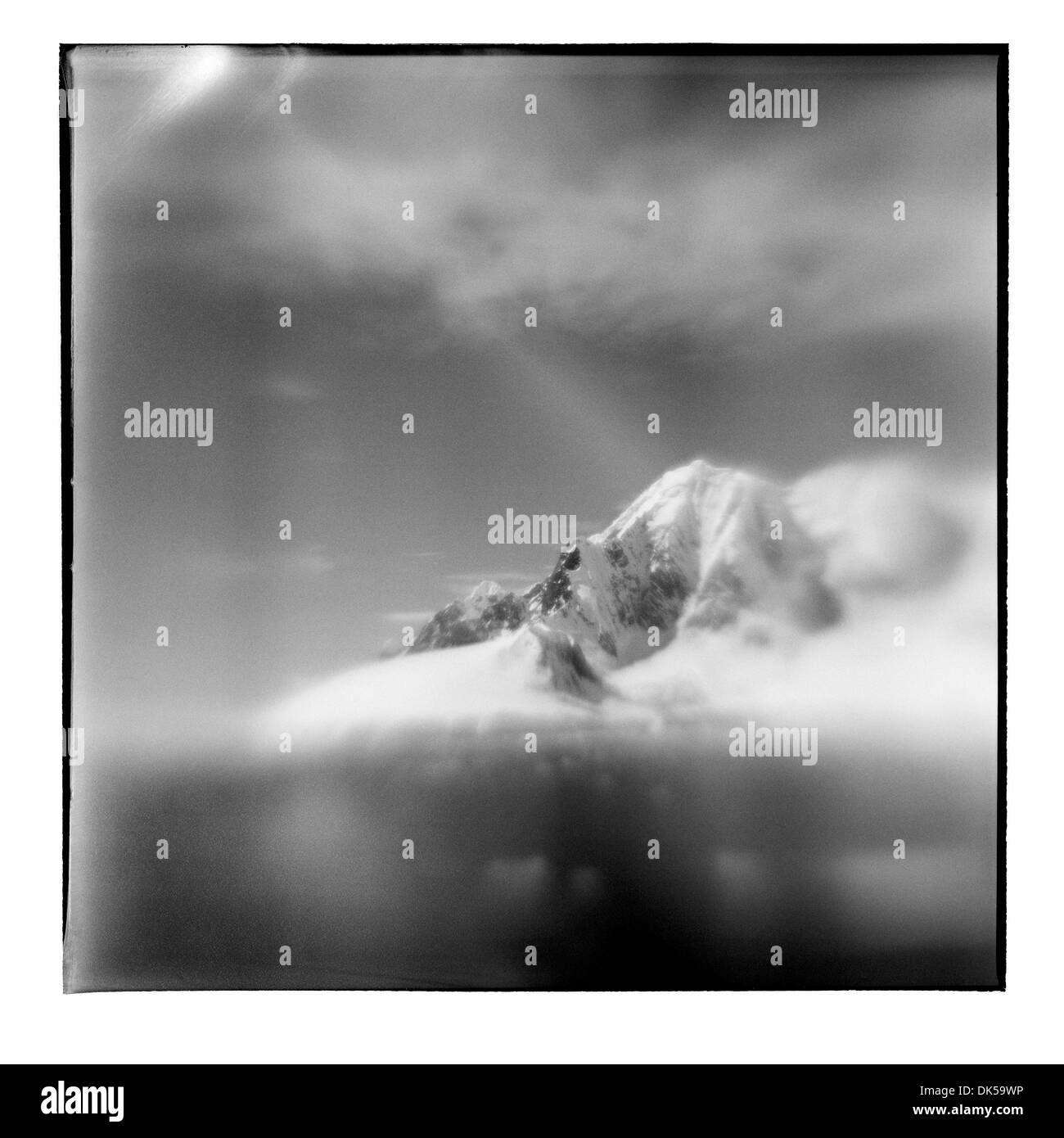 Antarctica, Blurred black and white image of mountain peaks along Lemaire Channel on sunny summer afternoon - Stock Image