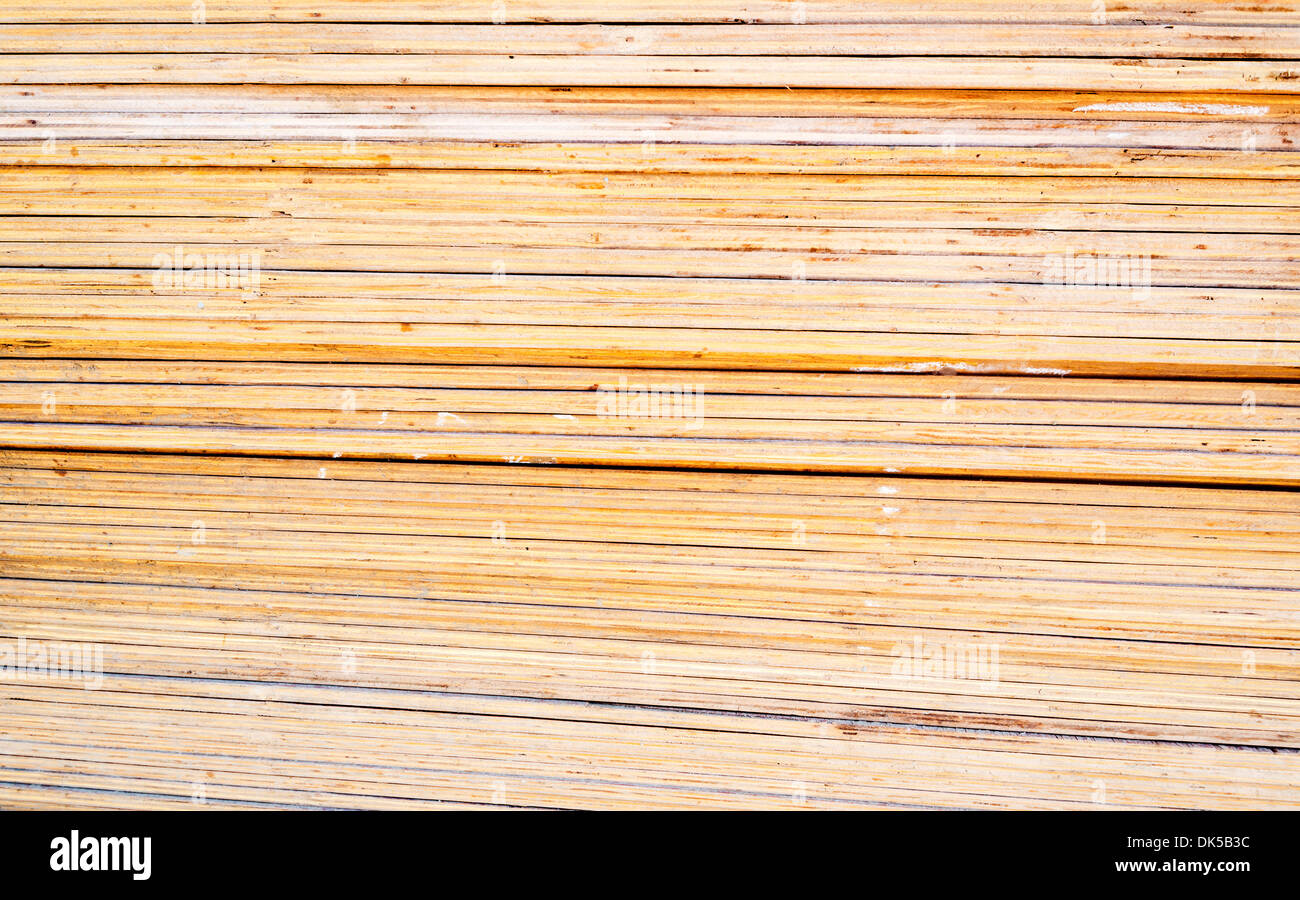 Weathered striped textured wooden planks background - Stock Image
