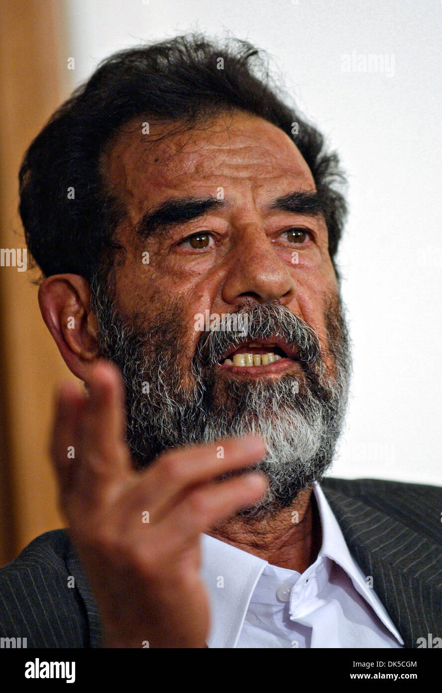 Former President of Iraq, Saddam Hussein gestures during his initial interview by a special tribunal after being captured July 2004 in Baghdad, Iraq. - Stock Image