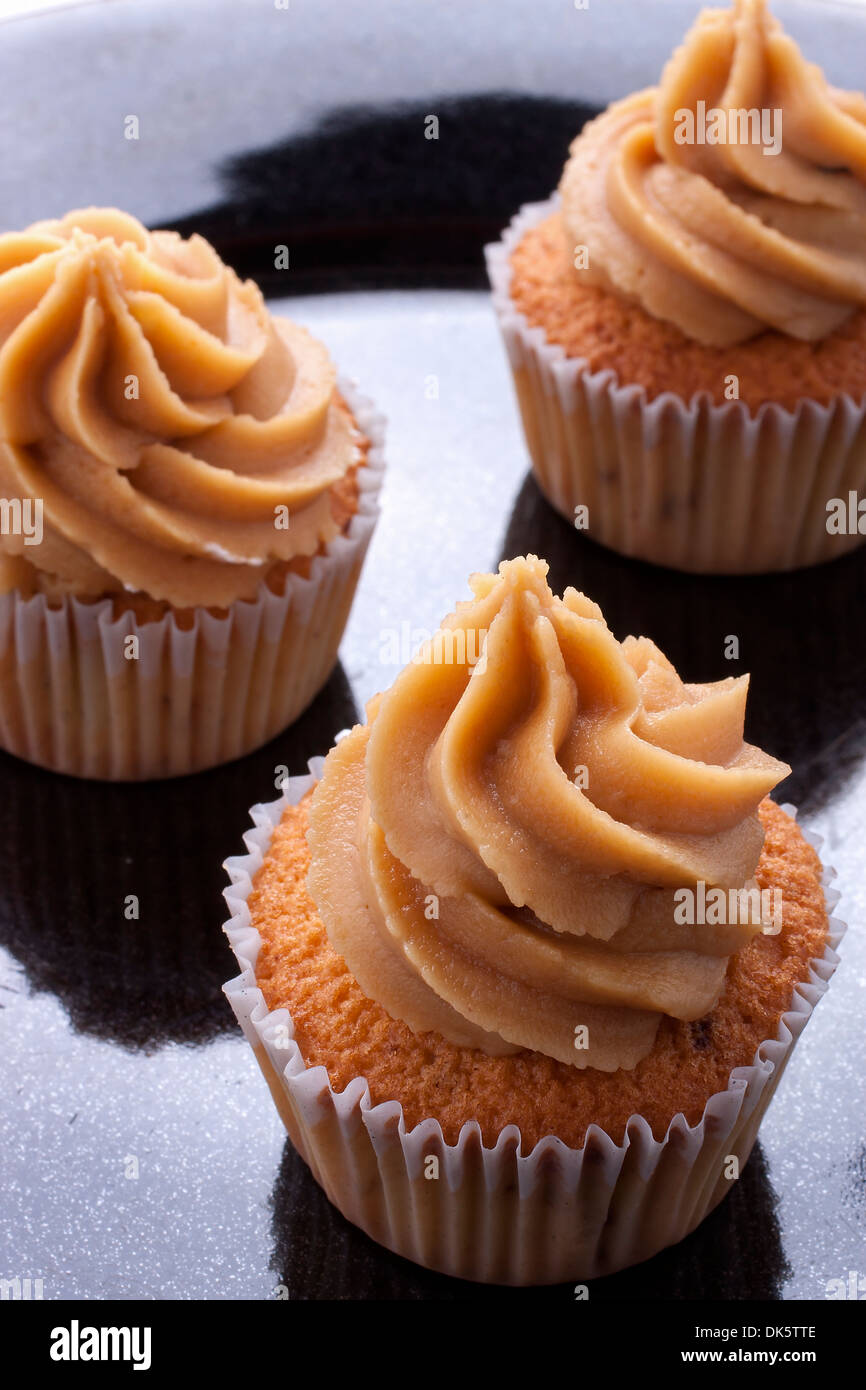 coffee cupcake including a coffee buttercream icing on top. - Stock Image