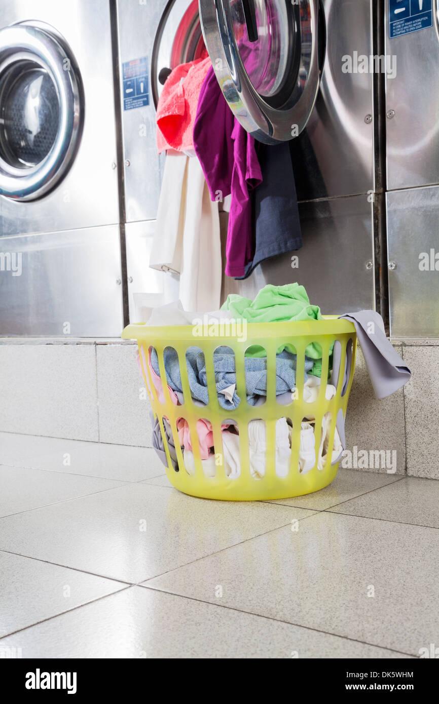 Overloaded Washing Machine And Laundry Basket - Stock Image