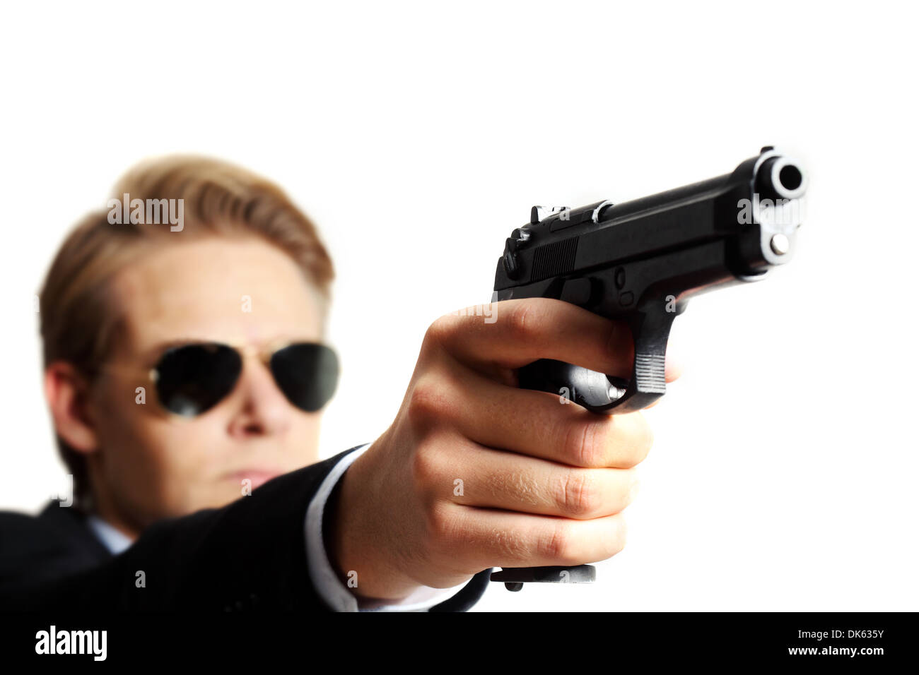 criminal with a gun on white background - Stock Image
