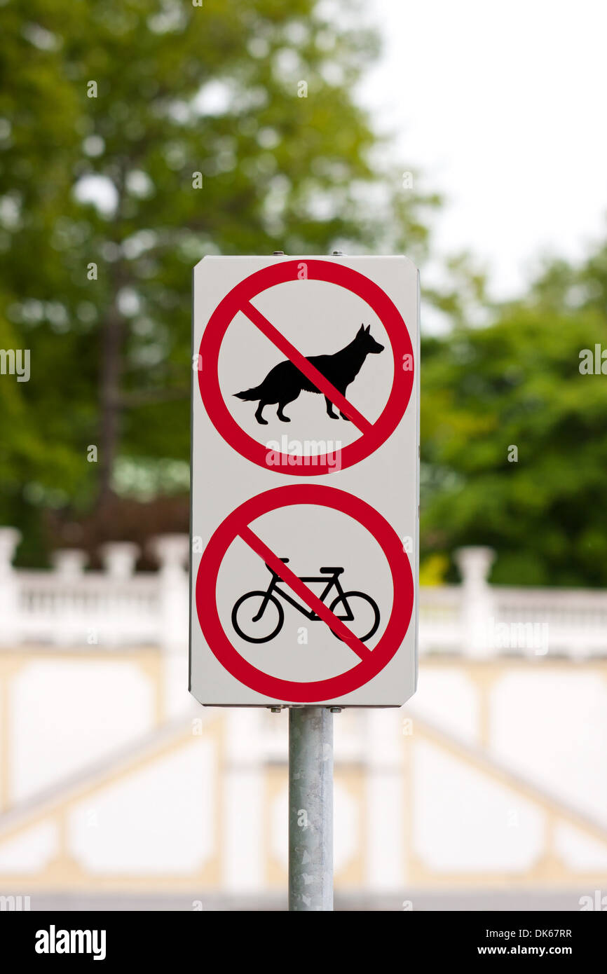 Traffic sign prohibits entrance for dogs and riders, bicyclists and cyclist - Stock Image