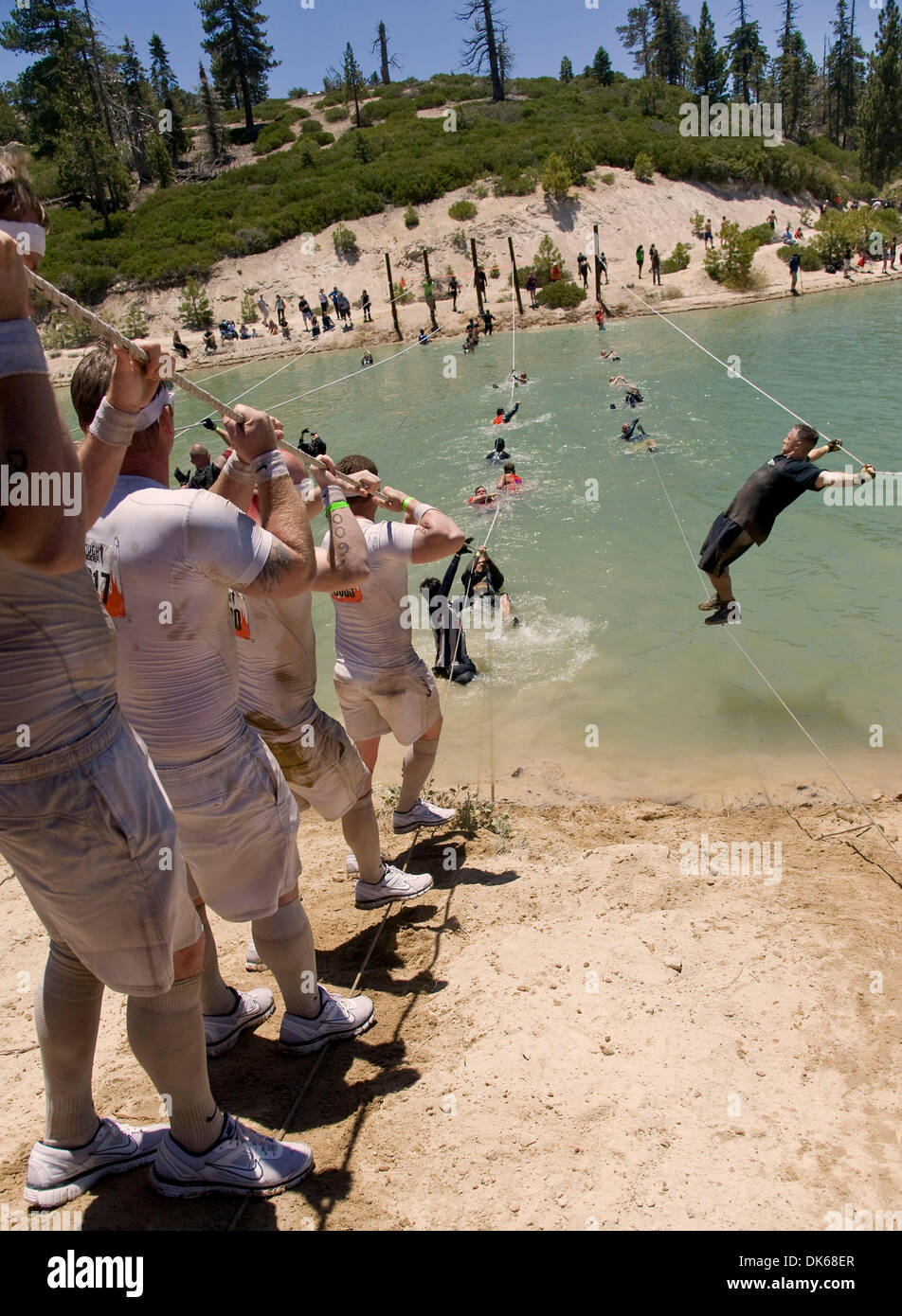 May 28, 2011 - Running Springs, CA, USA - Participants in Tough Mudder Southern California negotiate 'Walk the Plank,' one of the 23 obstacles on the 10- mile course built by British Special Forces.  Tough Mudder is billed as ''probably the toughest event on the planet.(Credit Image: © Brian Cahn/ZUMAPRESS.com) - Stock Image