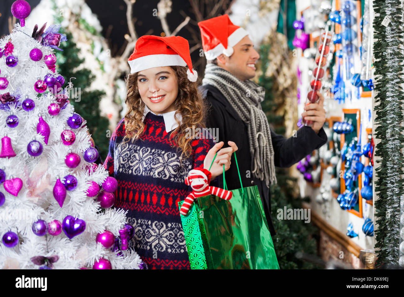 Man And Woman Shopping In Christmas Store - Stock Image