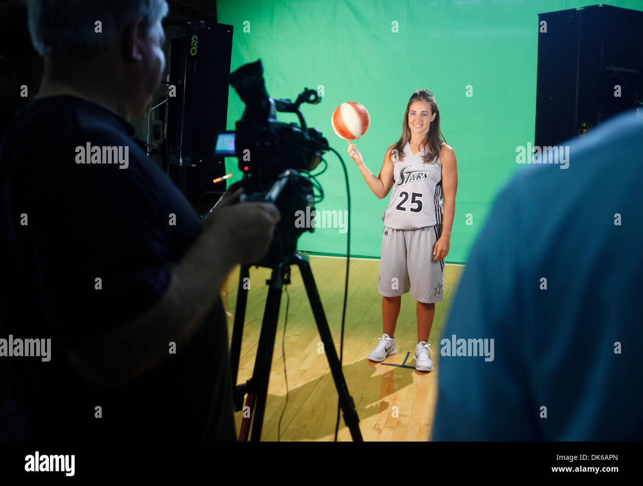 May 19, 2011 - San Antonio, TEXAS, USA - The WNBA's Silver Stars Becky Hammon performas in front of a green screen Wednesday May18, 2011 during the team's media day at their practice facility, the Antioch Baptist Church recreation center. (Credit Image: © San Antonio Express-News/ZUMAPRESS.com) - Stock Image