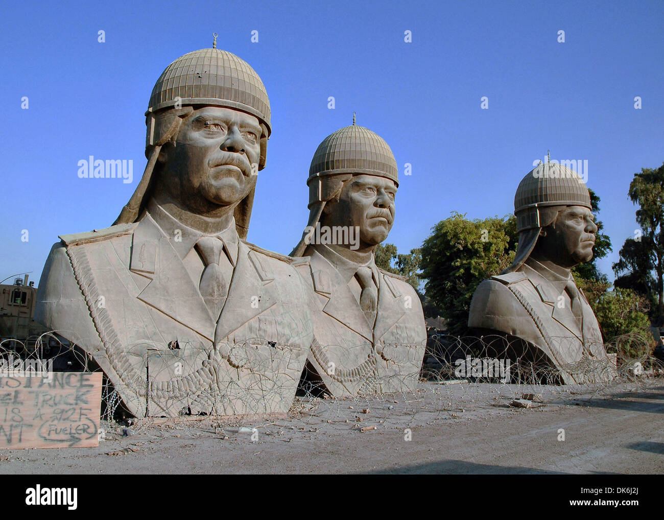 Thirty-foot tall bronze sculptures of former Iraqi dictator Saddam Hussein, sit on the grounds of the Republican - Stock Image