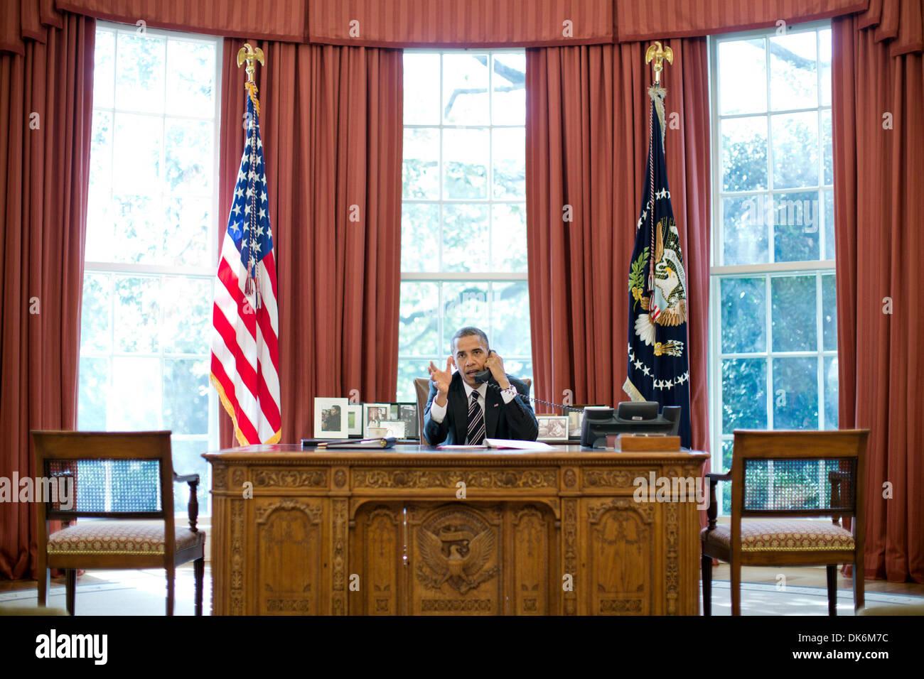 U.S President Barack Obama talks on phone with Israeli Prime Minister Benjamin Netanyahu in Oval Office Washington D.C.  - Stock Photo