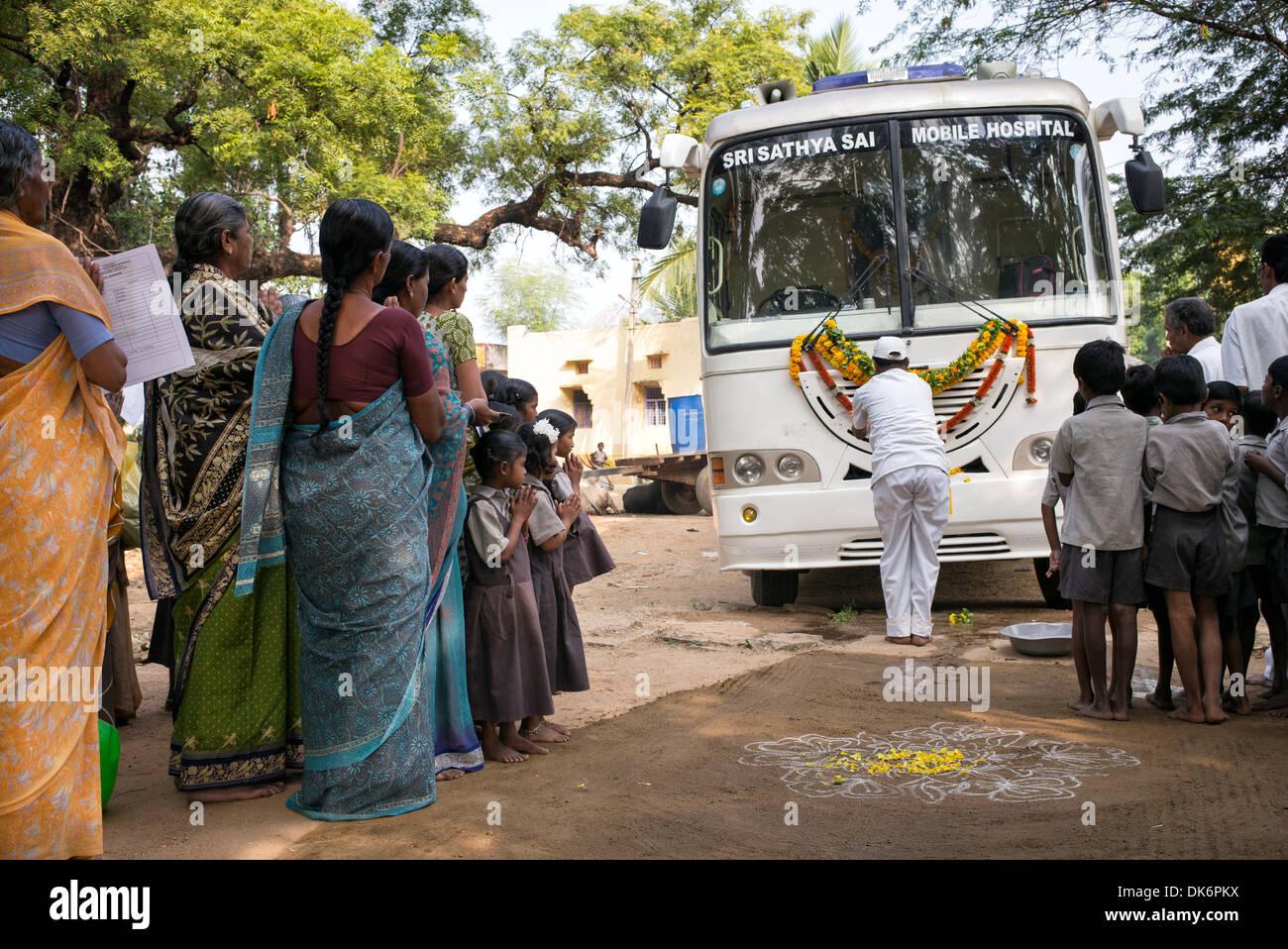Sri Sathya Sai Baba mobile outreach hospital service clinic bus at a
