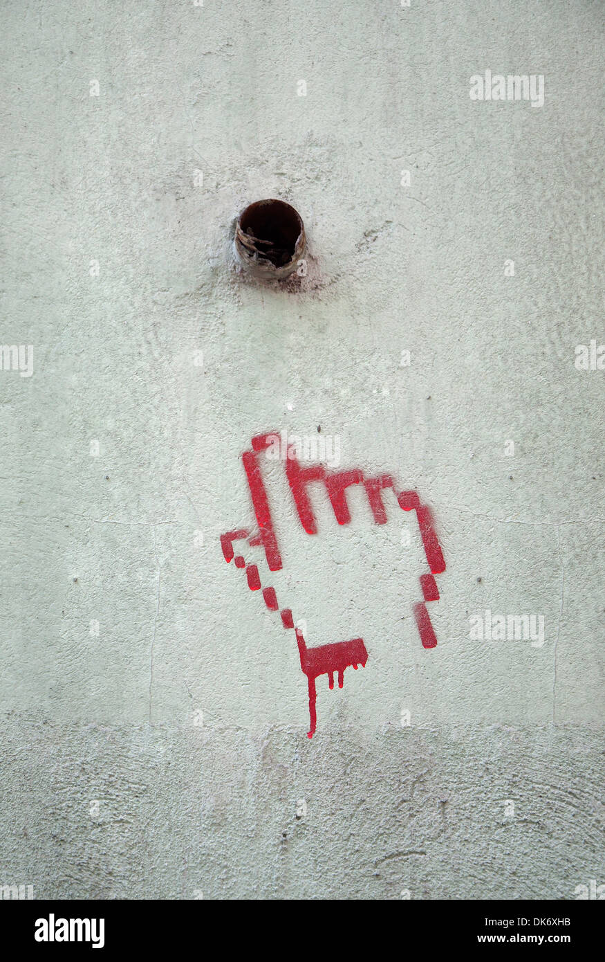 Red Spray paint of Hand on cement wall - Stock Image
