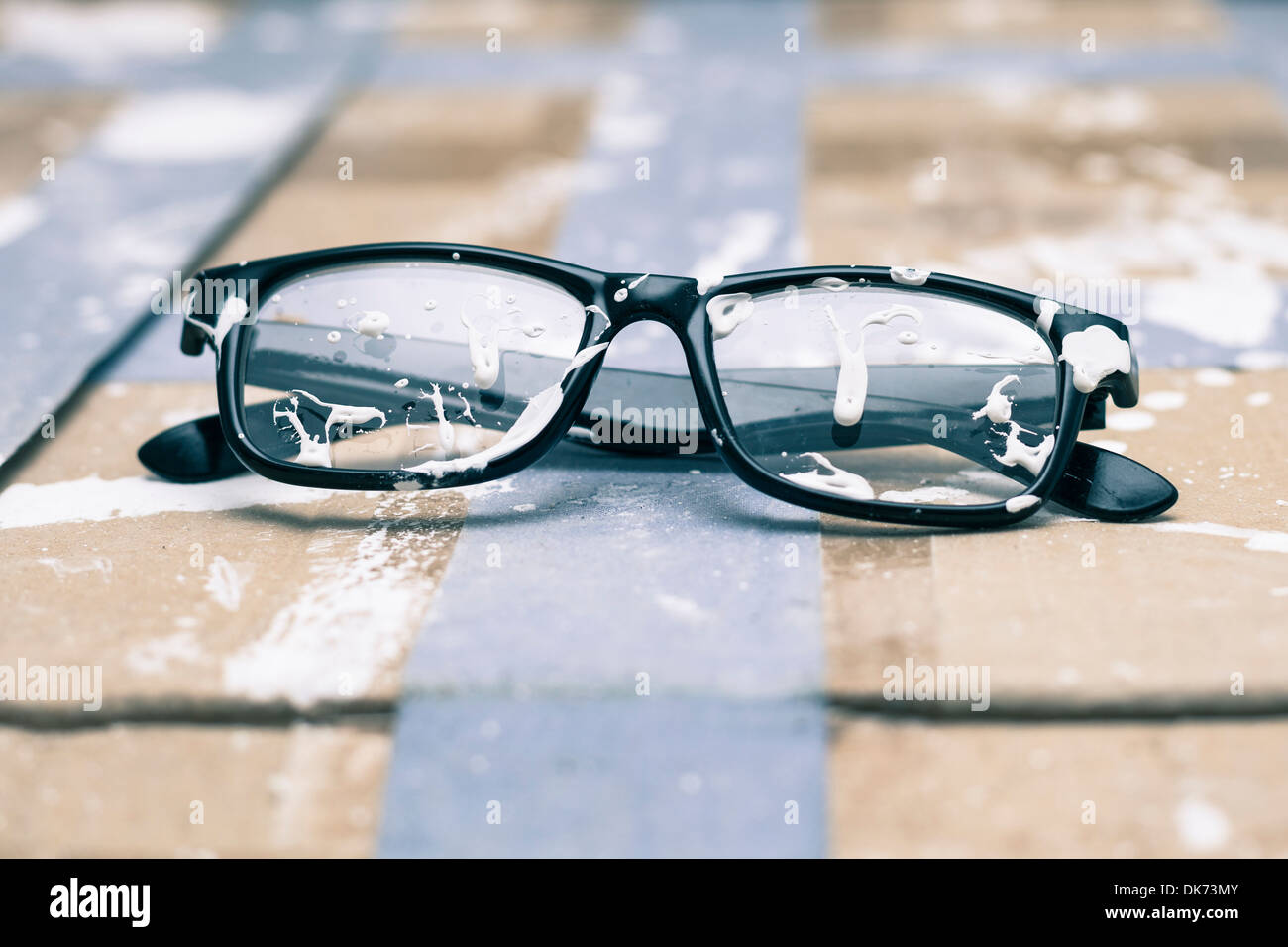 Creative vision conceptual photo, stained eyeglasses on paint background. - Stock Image