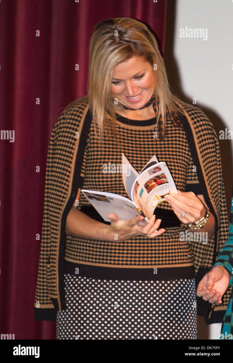 Leiden, The Netherlands. 03rd Dec, 2013. Queen Maxima of The Netherlands attends the 10th anniversary symposium of the Autism Cafe at the Volkshuis in Leiden, The Netherlands, 03 December 2013. The Queen receives the first copy of the book 'Autism Cafe, the power of parents'. The Autism cafe offers parents of children with autism information and help from experts and an opportunity to meet other parents. Photo: Albert Philip Van Der Werf/dpa - -/dpa/Alamy Live News - Stock Image