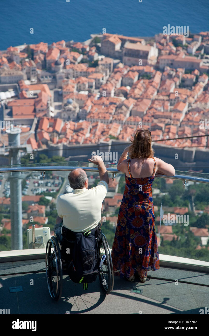 Dubrovnik, Croatia. A view from the cable car looking down onto the old town with a man in a wheelchair - Stock Image