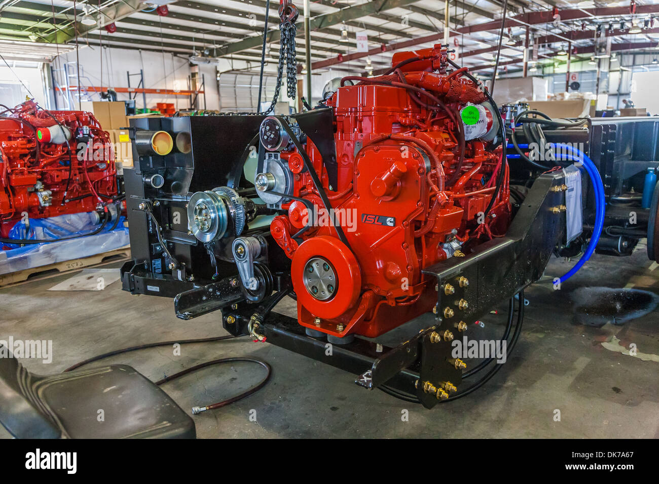 Cumins ISL diesel engines being installed onto chassis at Tiffin Motorhomes factory in Red Bay, Alabama, USA - Stock Image