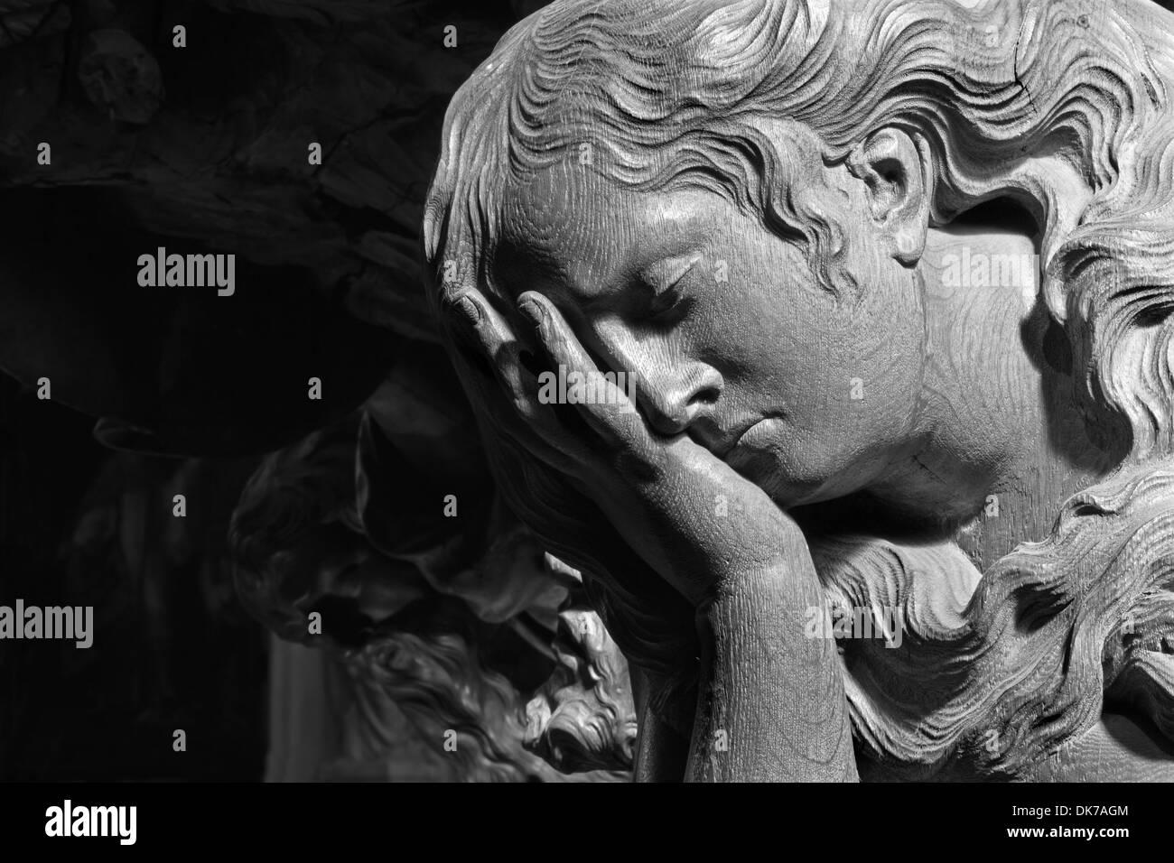 MECHELEN - SEPTEMBER 4: Carved relief of cried angel in Onze-Lieve-Vrouw-va n-Hanswijkbasiliek church - Stock Image