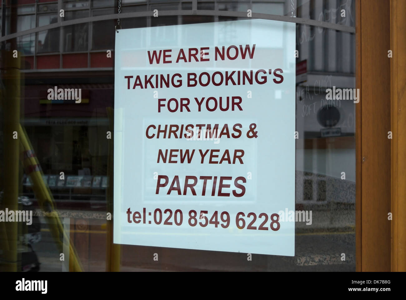 unnecessary apostrophe on a sign advertising christmas and new year parties at a restaurant in kingston, surrey, - Stock Image