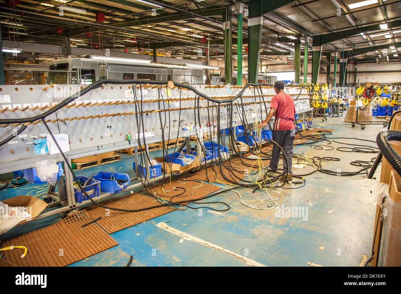 Man fabricating wiring harnesses on a rack at Tiffin Motorhomes factory in  Red Bay, Alabama