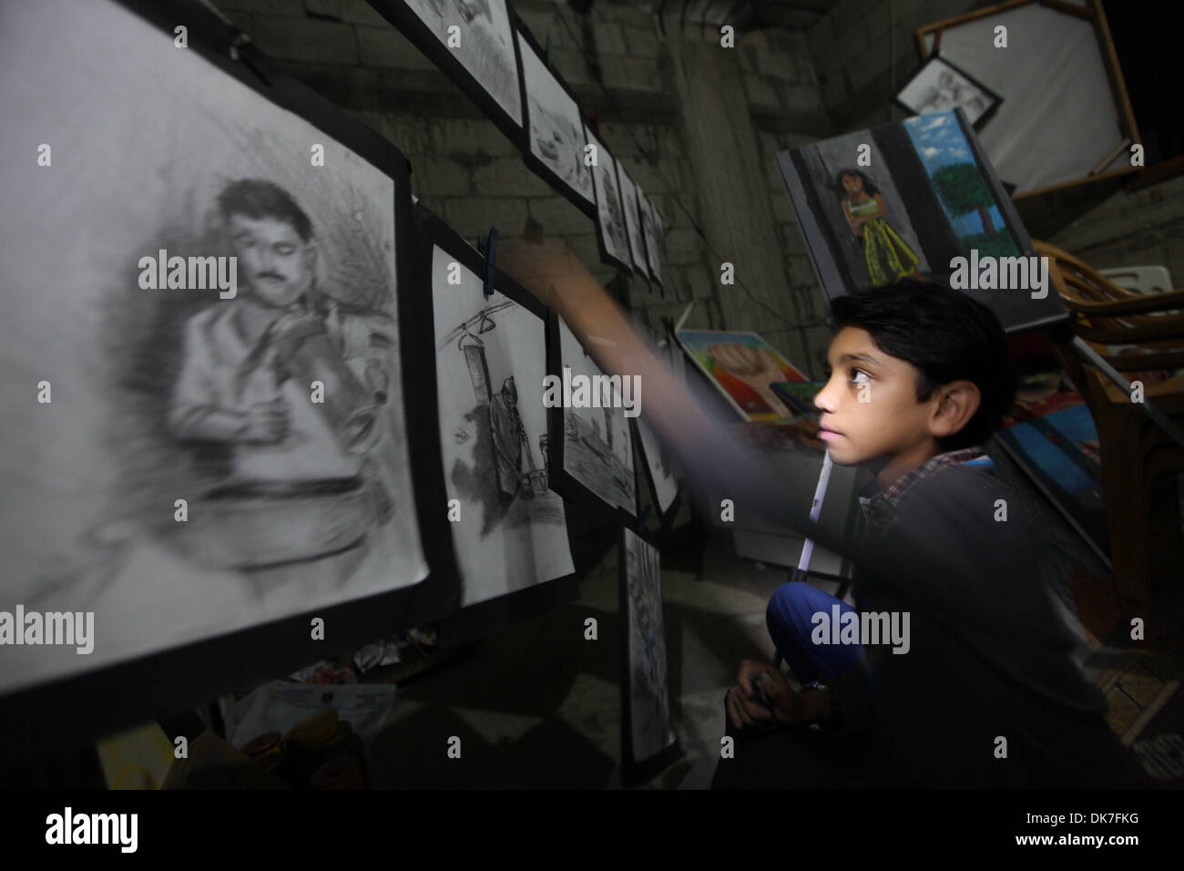 Dec. 3, 2013 - Gaza, Palestinian Territories - Mohammed Qraqia 12 years-old, A Palestinian boy draws paintings artwork at his bedroom in Shijaia neighborhood in the eastern of Gaza city, Mohammed draws since his childhood when his age was 5 years...Photo: Moemen Faiz/NurPhoto (Credit Image: © Moemen Faiz/NurPhoto/ZUMAPRESS.com) - Stock Image