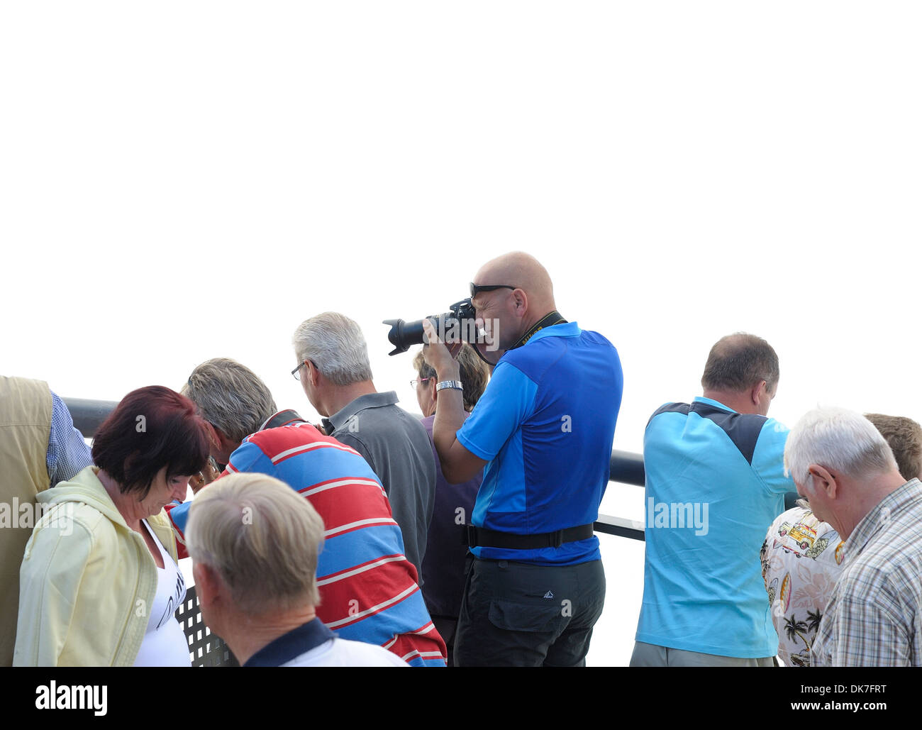A photographer taking a photograph with an SLR camera - Stock Image