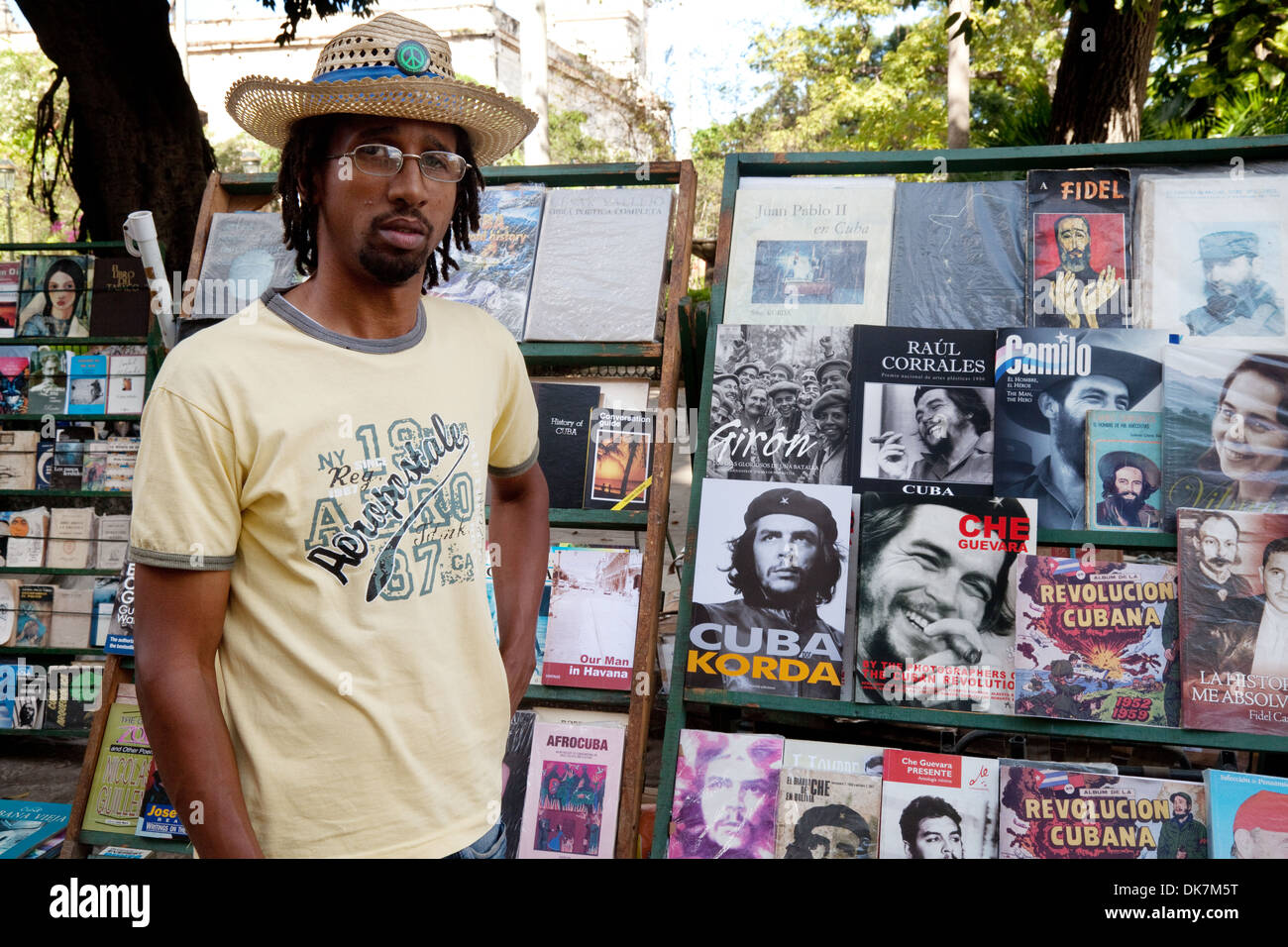 A cuban bookseller and stall of second hand books mainly about the revolution, Plaza de Armas square market, , Havana cuba, Caribbean, Latin America - Stock Image