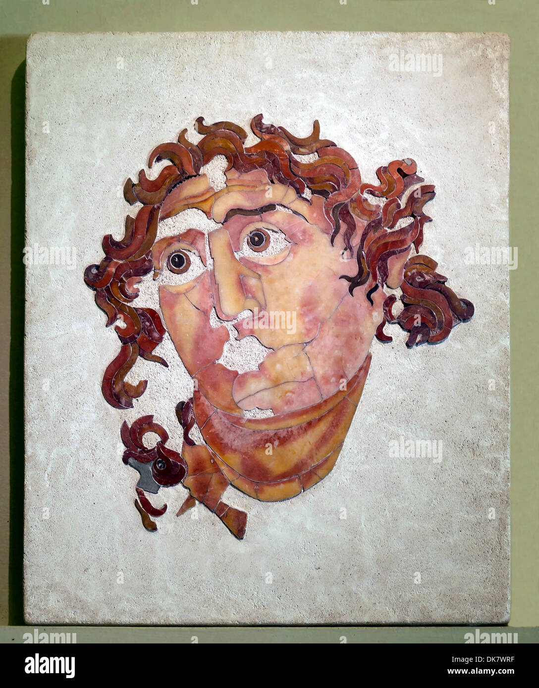 Head of Helios in Opus sectile, from the Mithraeum of Santa Prisca on the Aventine. Polychrome marble inlays. First Thirty years - Stock Image