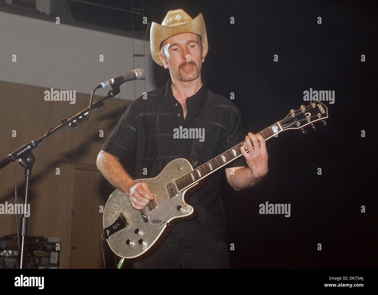 David Howell Evans, more widely known by his stage name The Edge, is a musician best known as guitarist, backing - Stock Image