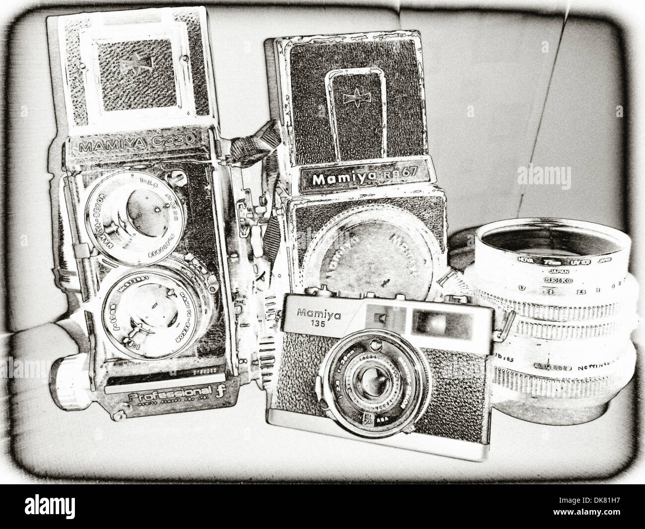 Solarised image of a collection of old, analogue Mamiya cameras and lens - Stock Image