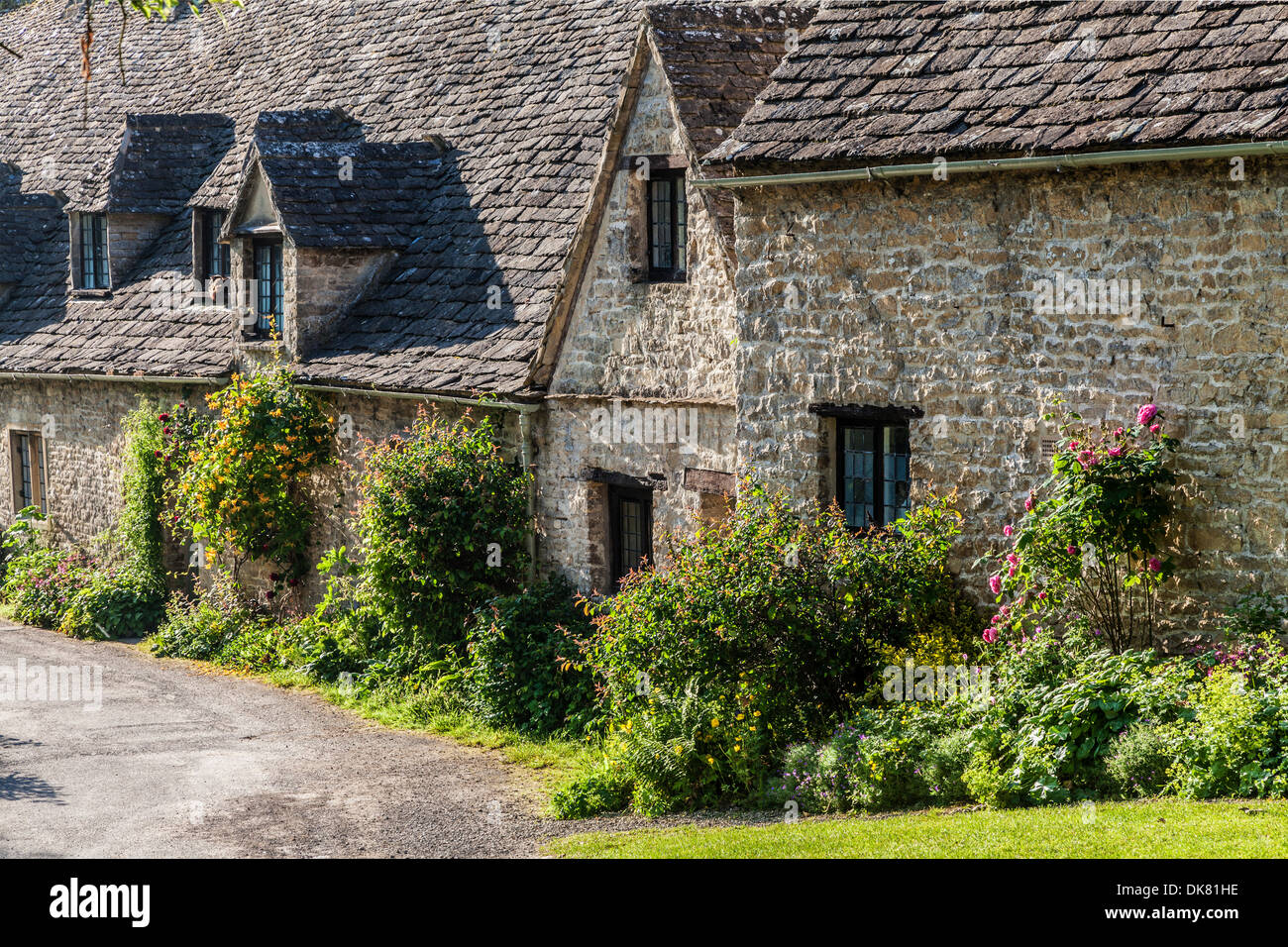 Part of the famous Arlington Row 14th century weavers' cottages in the Cotswold village of Bibury. Stock Photo