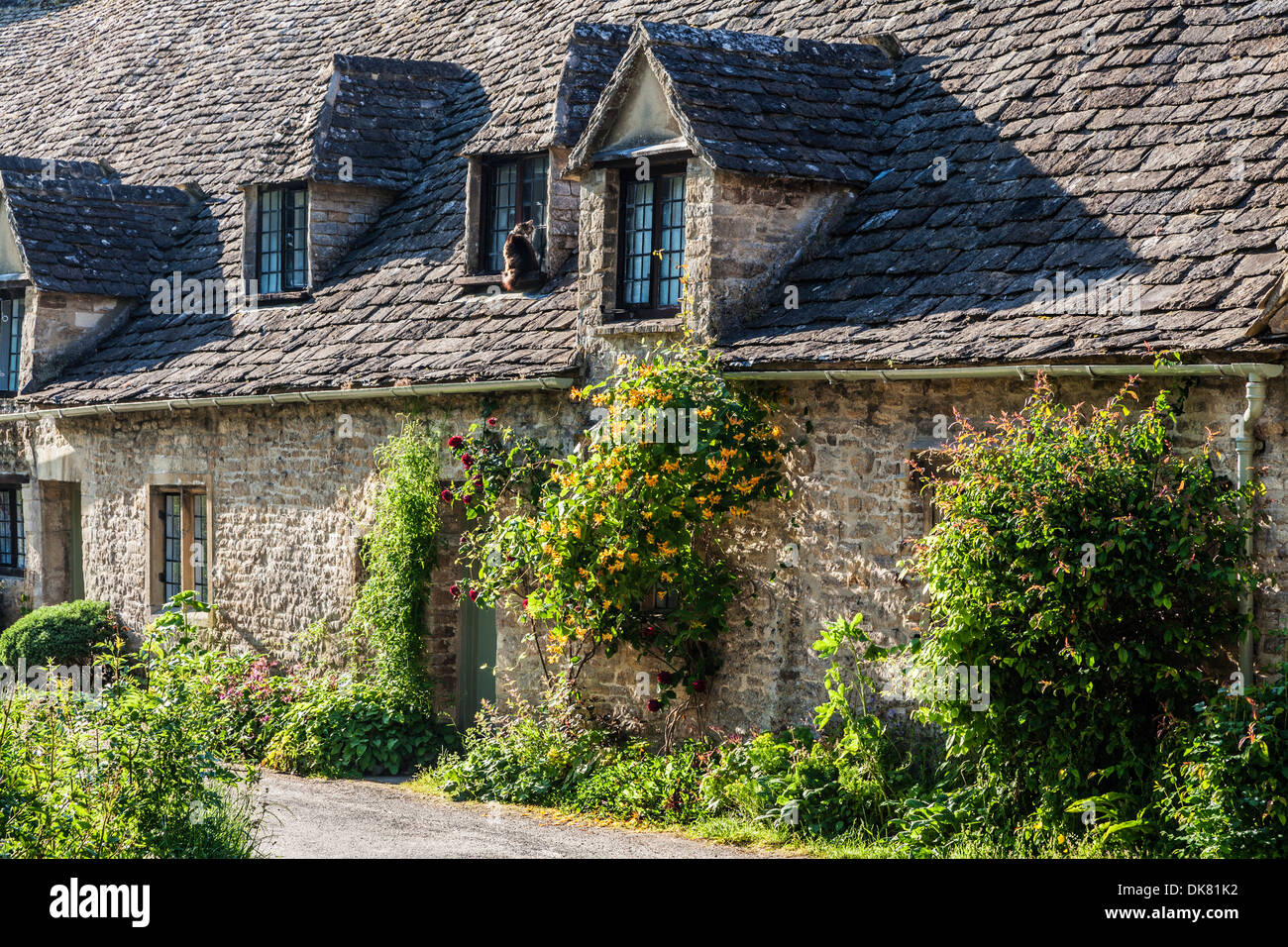 Part of the famous Arlington Row 14th century weavers' cottages in the Cotswold village of Bibury. - Stock Image