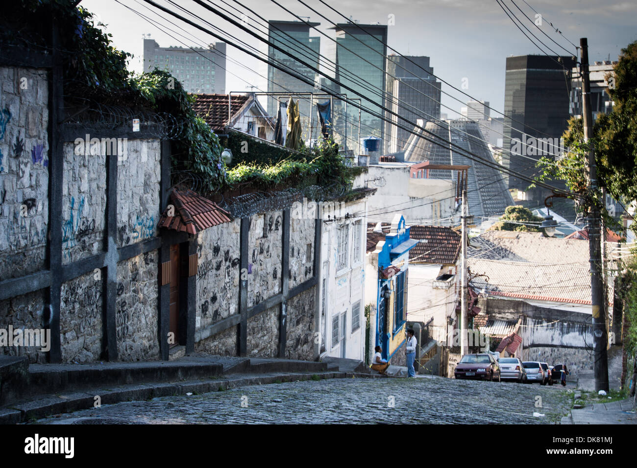Paved street of Santa Teresa street with Rio's business district in the background. Rio de Janeiro - Stock Image