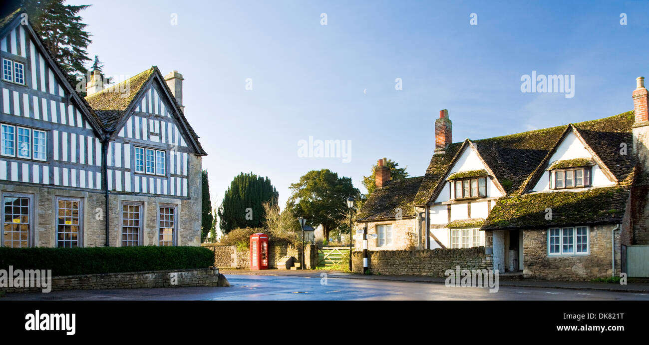 View of Lacock village in Wiltshire showing medieval wool merchants' half-timbered and stone houses. Stock Photo